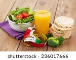 healthy food and tape measure... | Shutterstock . vector #236017666