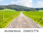 the gravel road with fences   Shutterstock . vector #236021776