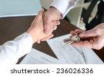 estate agent giving house keys... | Shutterstock . vector #236026336