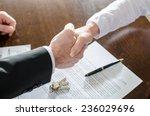 Estate Agent Shaking Hands Wit...