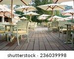 outdoor cafe with wooden floors   Shutterstock . vector #236039998