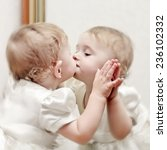 Cute Baby Kissing A Oneself...