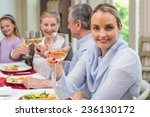 woman smiling at camera while... | Shutterstock . vector #236130172