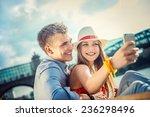 young couple doing selfie | Shutterstock . vector #236298496