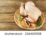 raw chicken on wooden table | Shutterstock . vector #236403508