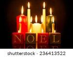 noel candles against a black... | Shutterstock . vector #236413522