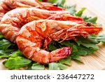 grilled prawns with rocket salad | Shutterstock . vector #236447272