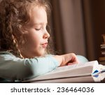 girl reading book. child... | Shutterstock . vector #236464036
