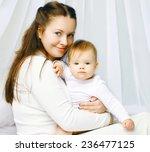 portrait happy mother and baby... | Shutterstock . vector #236477125