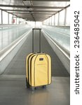 lonely yellow suitcase with... | Shutterstock . vector #236485042
