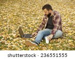 man laying down in autumn... | Shutterstock . vector #236551555