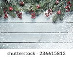 christmas tree branches on wood ... | Shutterstock . vector #236615812