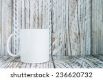 White Coffee Mug On Wood...
