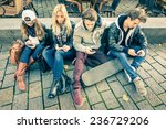 Small photo of Group of young hipster friends using smart phone with disinterest on each other - Modern situation of technology addiction in alienated lifestyle - Internet wifi connection on vintage filtered look