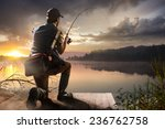 young man fishing at misty... | Shutterstock . vector #236762758
