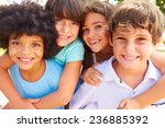 Stock photo group of children giving each other piggyback rides 236885392