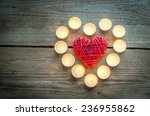 Heart With Burning Candles On...