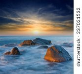 sunset on sea shore with stones ... | Shutterstock . vector #237021532