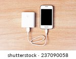 smartphone with a power bank... | Shutterstock . vector #237090058