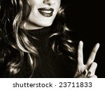 Victory sign and a smiling woman - stock photo