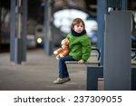 cute boy  sitting on a bench... | Shutterstock . vector #237309055