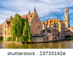 Canal In Bruges With The Famou...