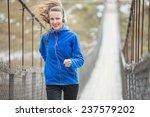 Winter running woman running on ...