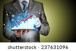 business man using tablet...   Shutterstock . vector #237631096