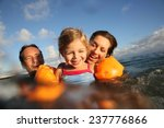 family swimming in sea at sunset | Shutterstock . vector #237776866