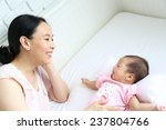 asian mother playing with her... | Shutterstock . vector #237804766