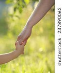 mother and son holding hand in... | Shutterstock . vector #237890062