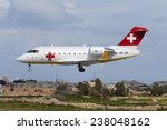 Small photo of Luqa, Malta February 17, 2005: REGA - Swiss Air Ambulance Bombardier Challenger 604 (CL-600-2B16) landing runway 32.