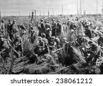 World War I, American soldiers of the 2nd Battalion, 307th Regiment await orders to advance north of La Four de Paris, U.S. Signal Corps photograph, 1918