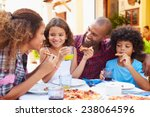 family eating meal at outdoor...   Shutterstock . vector #238064596