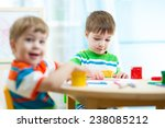 kids boys painting in daycare... | Shutterstock . vector #238085212