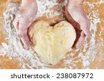 Woman Holding Dough Heart In...
