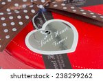 heart shaped tag on the gift box | Shutterstock . vector #238299262