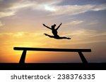 Silhouette Of Female Gymnast On ...