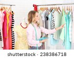 beautiful young stylist near... | Shutterstock . vector #238386718