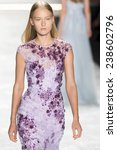 Small photo of New York, NY - September 5, 2014: Katya Riabinkina walks the runway at Monique Lhuillier show during Mercedes-Benz Fashion Week Spring 2015 at The Theatre at Lincoln Center