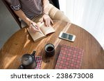 cropped image of woman writing... | Shutterstock . vector #238673008