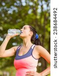 fit brown hair drinking from... | Shutterstock . vector #238684492