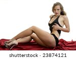 Leggy Model on Red Satin Throw. - stock photo