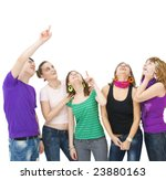 group of teenagers looking up and pointing towards something - stock photo
