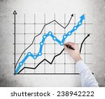 hand drawing business chart on... | Shutterstock . vector #238942222
