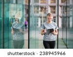 Smiling Young Woman In Modern...