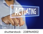 Small photo of Business concept image of a businessman pointing Actuating icon on virtual screen over blue background
