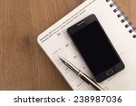 mobile phone  pen and agenda on ... | Shutterstock . vector #238987036