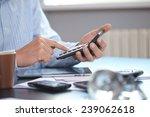 businessman with calculator | Shutterstock . vector #239062618