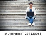young man sitting on the stairs ... | Shutterstock . vector #239120065